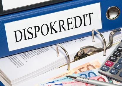 Dispokredit Ordner mit Geld im Bro - Kredit und Schulden